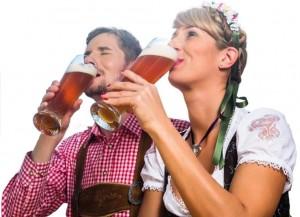 Couple on mountain hut drinking wheat beer
